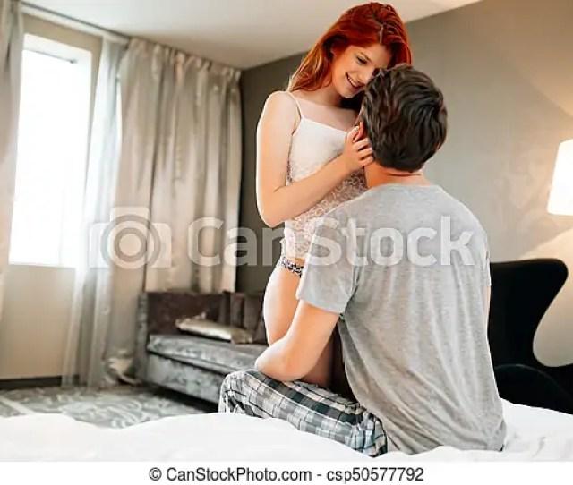 Happy Couple In Bedroom Csp50577792