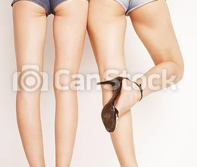 Legs Of Young Women Pair Butts In Jeans Shorts Csp31889584