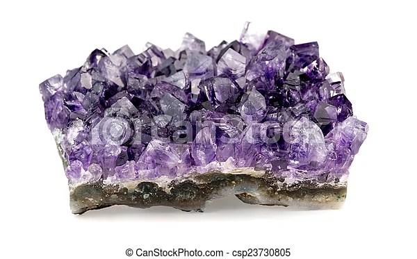 Macro closeup of purple amethyst geode on white background.