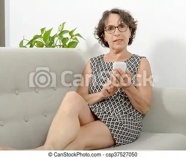Mature Woman On The Sofa With A Phone Csp37527050