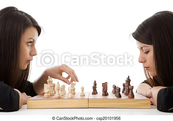 Next move. Young woman playing chess against herself shot in the studio.