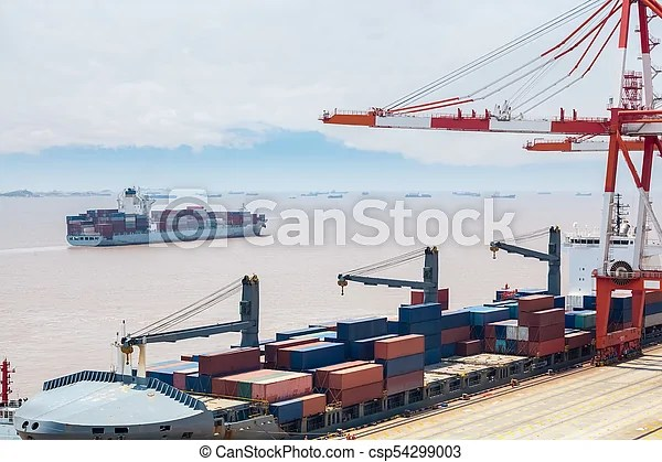 Ocean container terminal. Ocean-going freighter in shanghai container terminal.