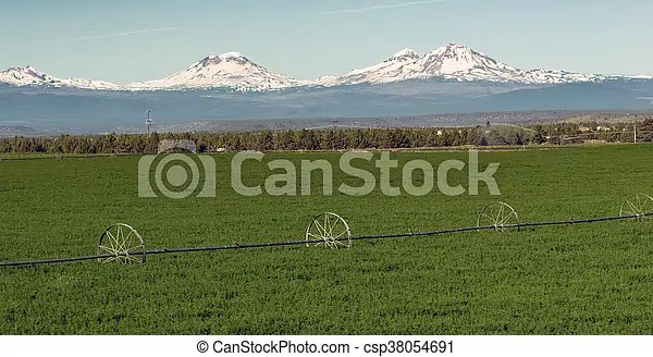 The oregon field guide team along the way. Oregon Cascade Mountain Range Farm Irrigation Tools Stand In The Farm Fields Near Three Sisters Mountains And Bend Oregon Canstock