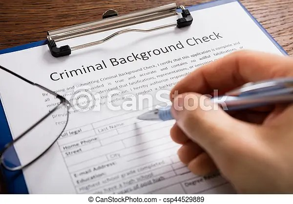 Person filling criminal background check application form  Close up     Person Filling Criminal Background Check Application Form   csp44529889