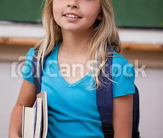 Portrait Of A Blonde Schoolgirl Holding Her Books Csp
