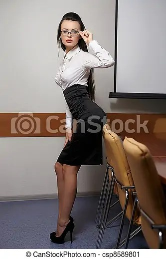 Portrait Of Young Sexy Business Woman In An Office With Glasses Red Lips Csp8589801