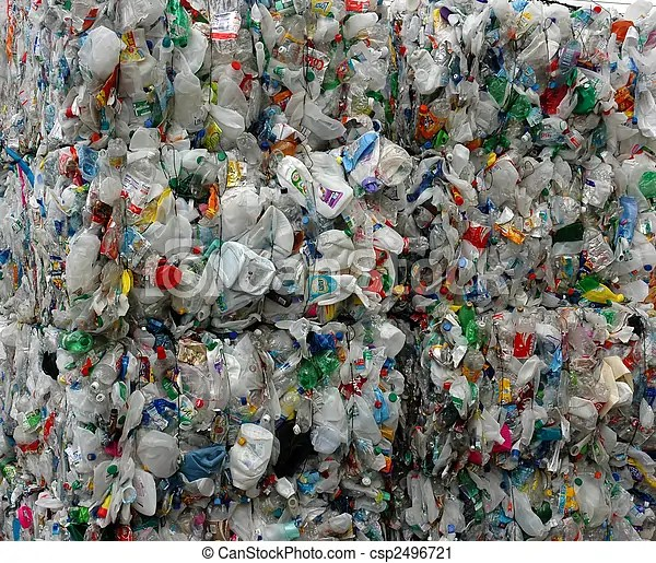 Recycled plastic. Stack of plastic waiting to be recycled at recycling plant.