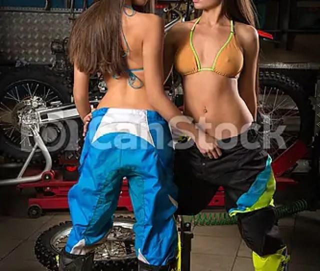 Sexy Girls In Motorcycle Garage Csp55471602