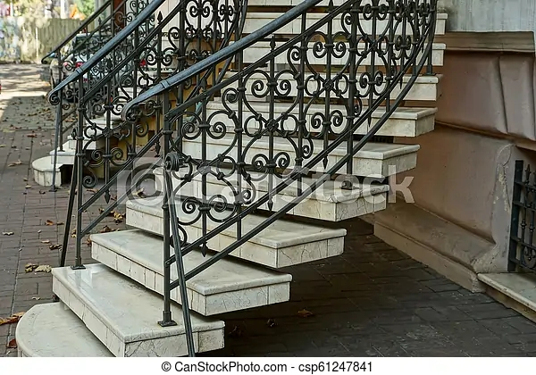 Staircase With Gray Concrete Steps And Iron Black Handrails With A | Building A Handrail For Concrete Stairs | Steel Handrail | Brick | Deck Railing | Outdoor Stair | Precast Concrete