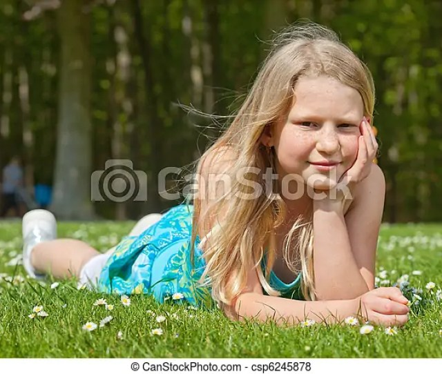 Teenager Girl Lying On Grass Csp6245878