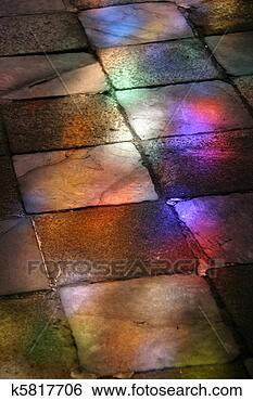 Stock Image - cobblestone with stained glass window light. Fotosearch - Search Stock Photography, Poster Photos, Pictures, and Photo Clip Art