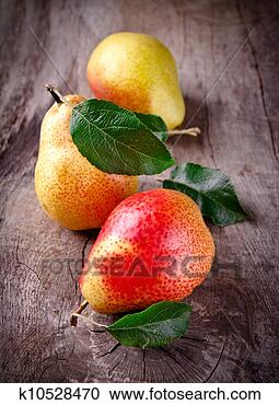 Stock Photography - harvested pears on old wooden background. Fotosearch - Search Stock Photos, Pictures, Wall Murals, Images, and Photo Clipart