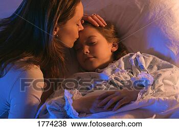 image of a mother putting her child to sleep, borrowed from fotosearch.com