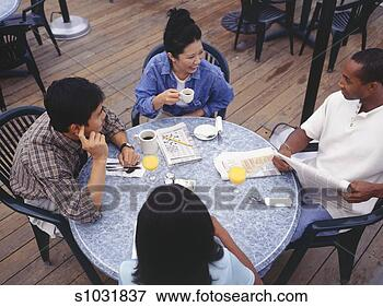Picture - young adults sitting  at outdoor cafe  together. fotosearch  - search stock  photos, pictures,  images, and photo  clipart