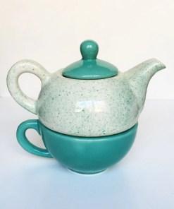 tetera y taza de cerámica esmaltados color verde
