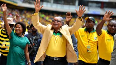 South Africa's President Zuma greets his supporters as he arrives for the launch of his party's election manifesto in Nelspruit