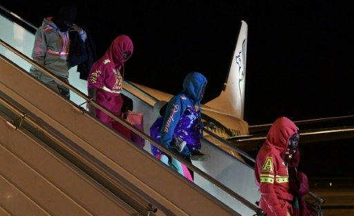 Retour de Libye à Abidjan de 155 migrants Ivoiriens après l'indignation provoquée par la vente aux enchères de d'Africains noirs dans ce pays   AFP   ISSOUF SANOGO