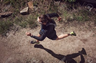 24914789-overhead-view-of-trail-runner-running-on-mountain-Stock-Photo