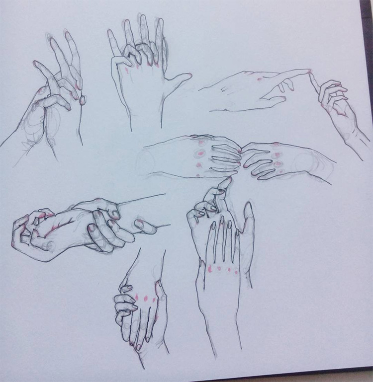 Grouped hands with knuckle drawings