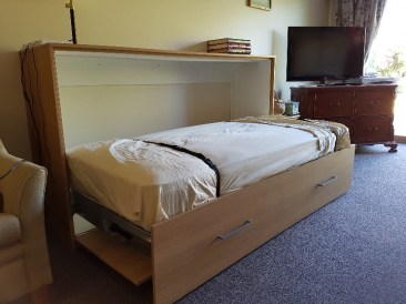 Lay down style folding bed unit in sublime teak riven finish