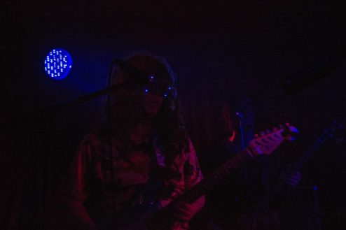 Acid Mothers Temple Guitarist Tabata Mitsuru with his light-up peace-sign sunglasses