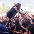 Levi Benton from Miss May I jumps in the crowd at the end of their final song. Photo by Emily Williams