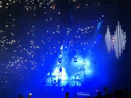 Cell phones illuminate Staples Center. Photo by Corey Kleinsasser