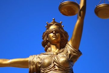 A statue of justice, blindfolded and holding a scale and sword.