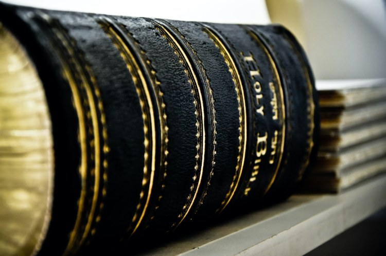 Image of a Bible on a shelf.