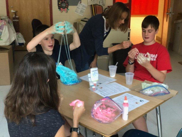Students making dragon slime.