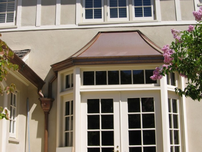 Copper sweep style bay window over eclipse millennium for Bay window roof framing