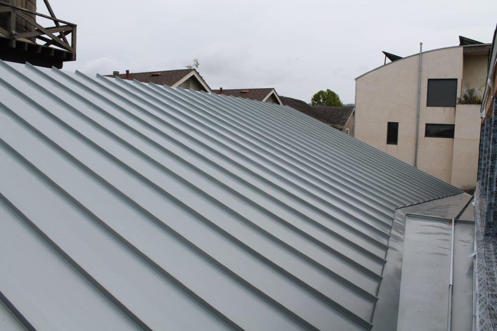 Blue Gray Rheinzinc Standing Seam Roof And Cricket