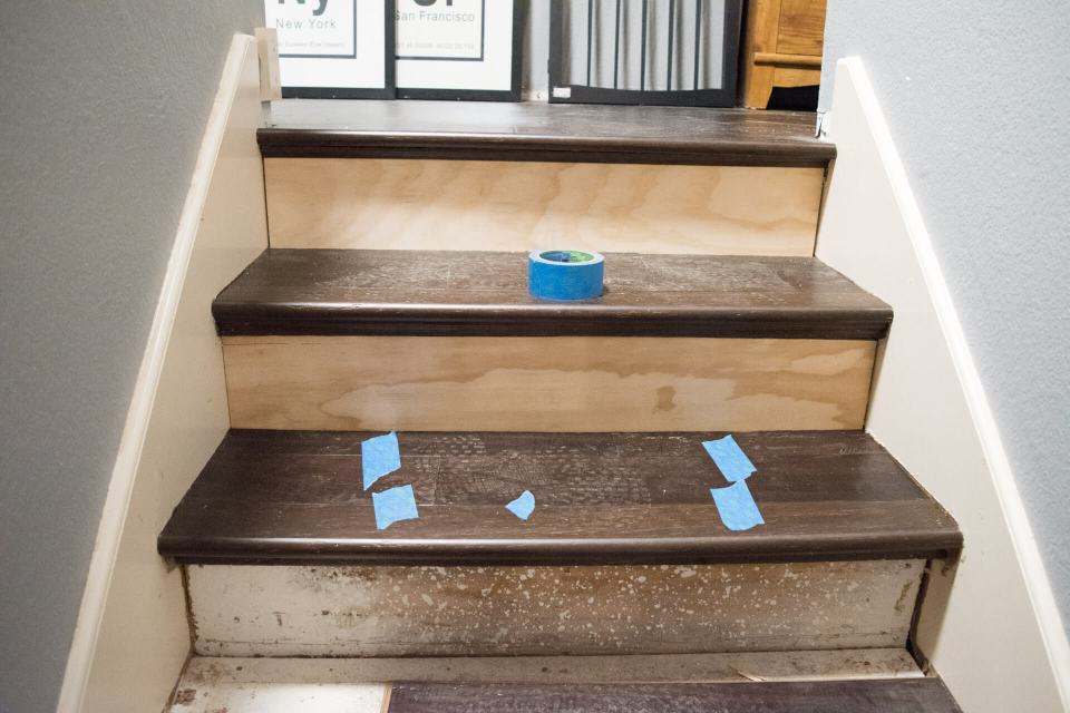 Install hardwood flooring on stairs with an existing nosing can be difficult, but I found a simple (and cost-effective!) solution. This DIY install is something that anyone can do - removing the carpet from our stairs let us choose a much better runner with a great design, and it completely transformed our entryway. #stairs #stairrunner #makeover #stairsDIY #stairrenovation