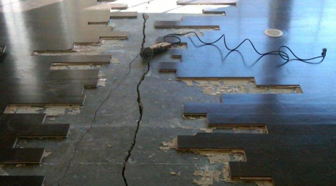 Concrete slab under wood floor crack repair.