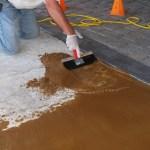 Concrete repair under decorative coatings.
