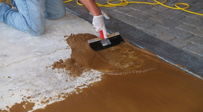 Concrete repair under decorative coatings.