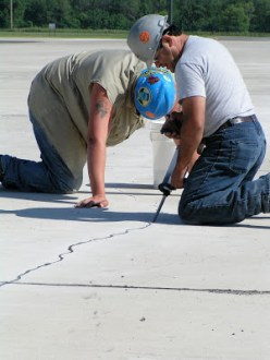 Parking lot crack filling with Flexible Cement II™.