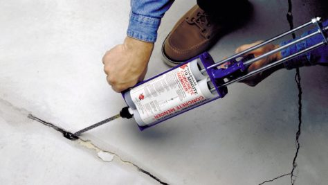 600ml cartridge of Roadware 10 Minute Concrete Mender repairing a crack in concrete.