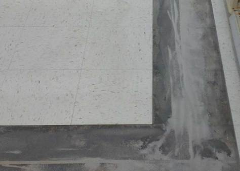 Control or contraction joints repaired with 10 Minute Concrete Mender™ under VCT.