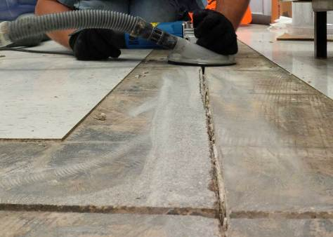 Repairing control or contraction joints under VCT.