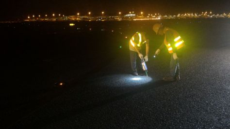 Maintenance workers repair the taxiway with Roadware Flexible Cement II.