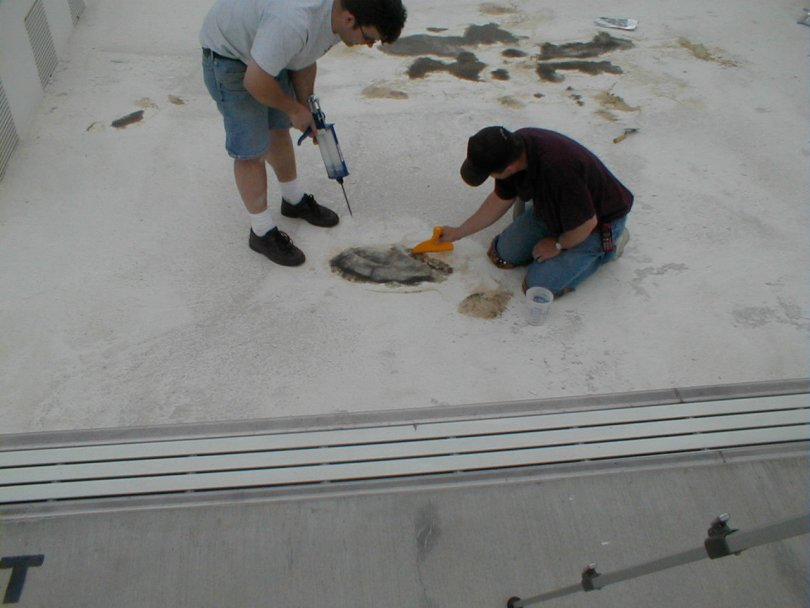 Roadware 10 Minute Concrete Mender mixed with sand is troweled into place in a city pool.