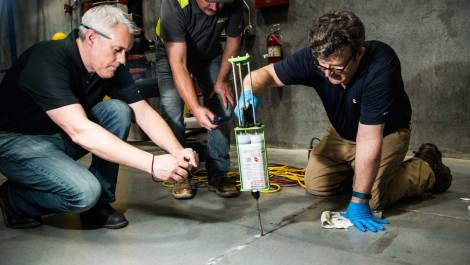 Concrete repair experts use Roadware Easy Injection and Concrete Mender to repair cracks in a auto parts warehouse.