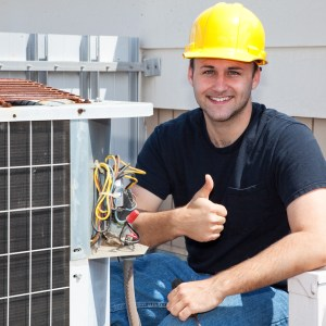 Air conditioning repairman working on a compressor