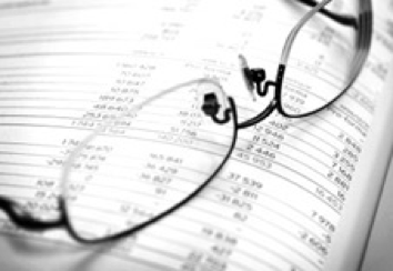 Glasses resting on an accounting book.