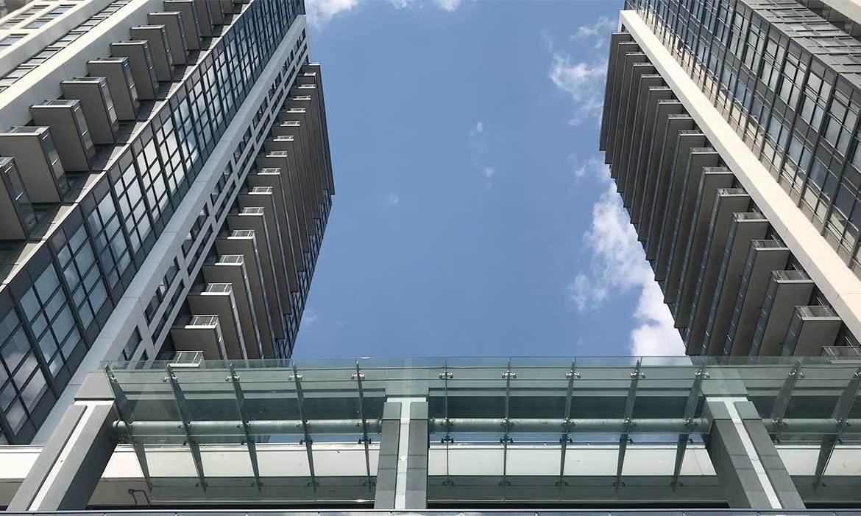 Exterior bottom-up image of IQ Condos Toronto.