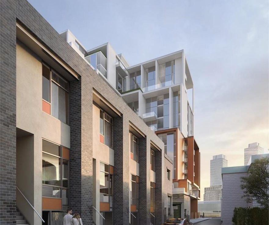 Exterior rendering of 28 Eastern Condos townhomes at street-level.