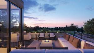 Rendering of Birchcliff Towns rooftop patio at night.