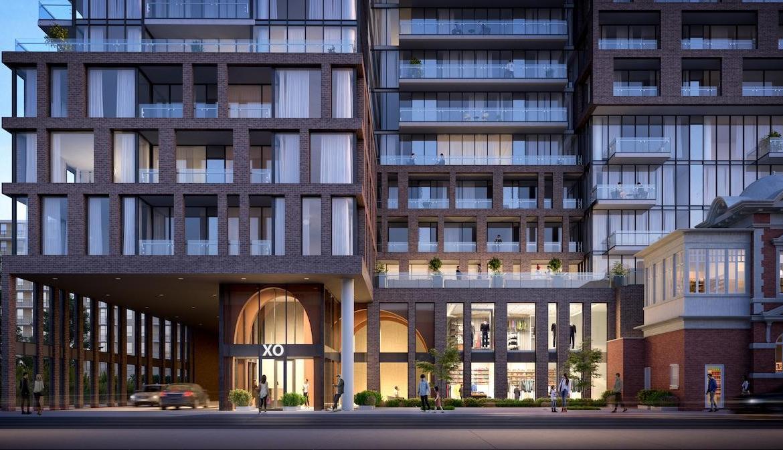 Exterior building entrance rendering of XO Condos in Toronto.