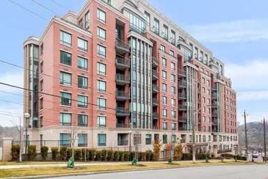 Exterior image of the Riverhouse at The Old Mill Condos in Toronto